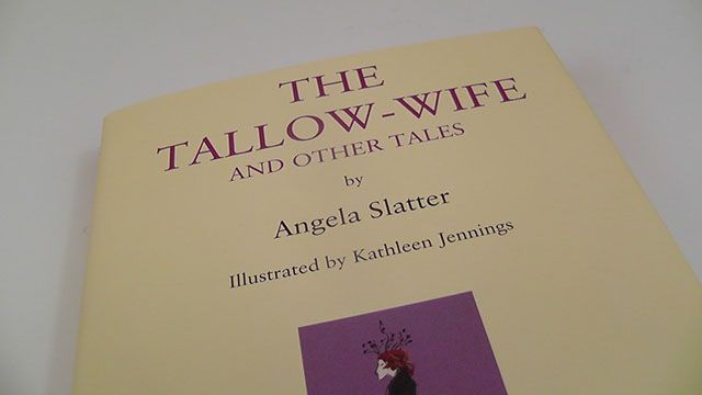 The cover of The Tallow-Wife, cream with a small purple rectangle with an illustration of a pale crowned woman