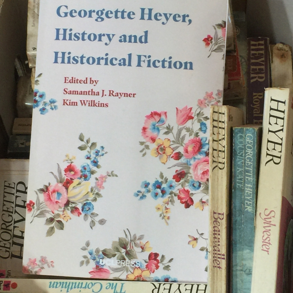 "Picture of the ""Georgette Heyer, History and Historical Fiction"" book in a box of old Heyers novels."