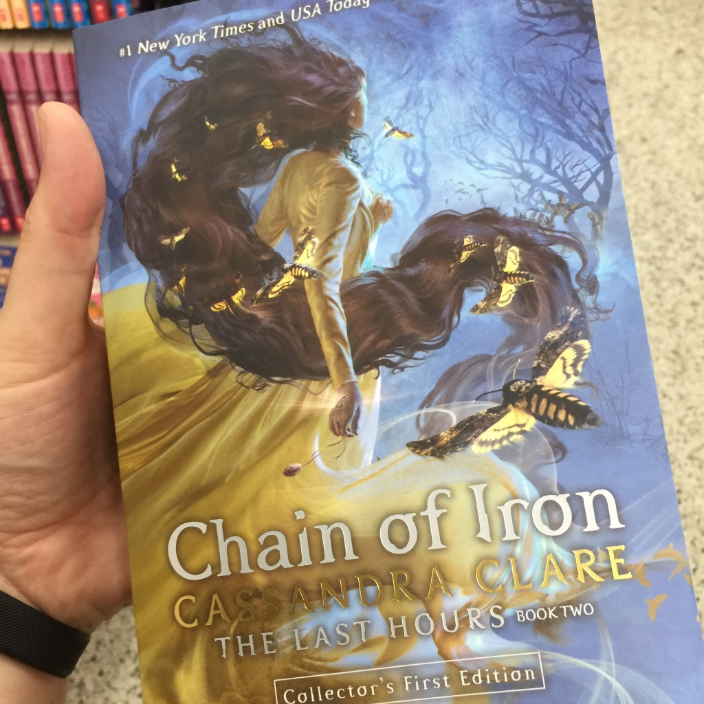 Cover of Chain of Iron, with a girl with long red hair and a yellow dress